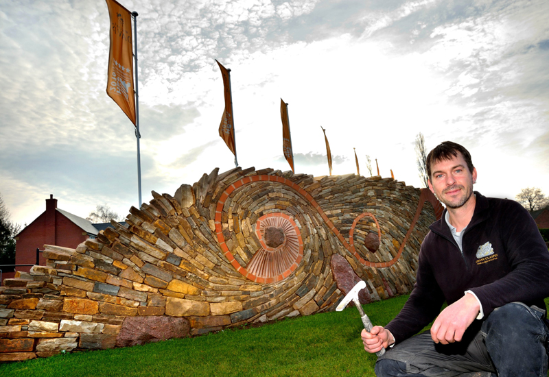 Stone sculpture welcomes visitors to new development
