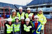 Village pupils tour construction site as new homes take shape