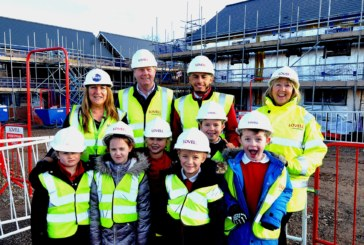 Village pupils tour construction site as new homes take shape