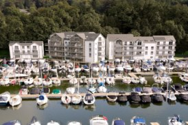 Windermere Marina development progresses as building structures completed